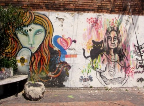 old woman and cat graffiti