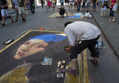 street artist painting
