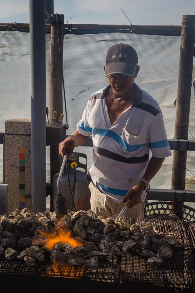 Qigu Lagoon Tainan Man Grilling Oysters